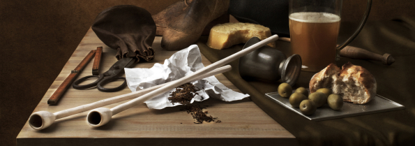 Photographic still life with clay pipes in the style of Dutch paintings of the XVII century.