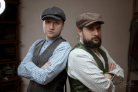 Men in tweed caps and waistcoats