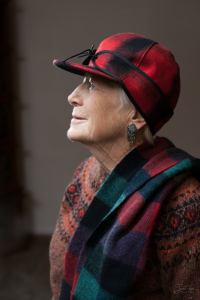 The woman in Red-Black Stormy Kromer Mackinaw Cap