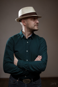 The man in Natural Toquilla Straw Trilby Small Brim Panama Hat by K.Dorfzaun