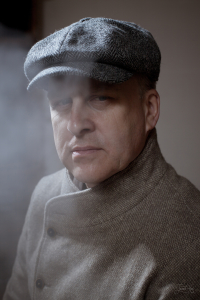 The man in Grey Kells Tweed 8-piece Cap by Hanna Hats and Jacket Infundibulum