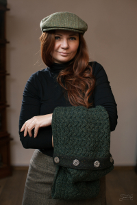 The woman in Green Herringbone Tweed Vintage Cap by Hanna Hats