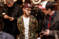 Ilya Zotov (Red Hills) and barber Santiago Green in the Tweed Hat showroom