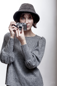 The woman in Grey Tweed Eske Hat by Hanna Hats