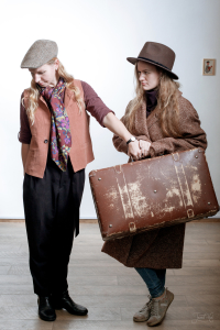 Women in hats with a suitcase