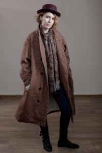 The woman in a Terracotta Tweed Coat Infundibulum Fair Collection