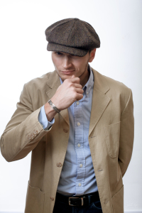 The man in Heather Tweed 8-piece Cap by Hanna Hats