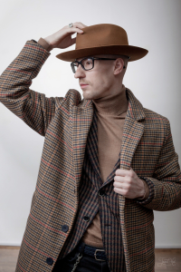 The man in Cinnamon Furfelt Fedora Hat with Silk Lining by Tonak